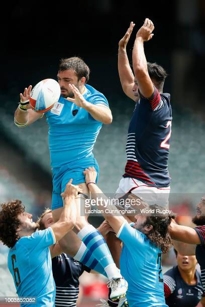 Max Denmark of Hong Kong evades a tackle by Gaston Mieres of Uruguay during day three of the Rugby World Cup Sevens at ATT Park on July 22 2018 in...