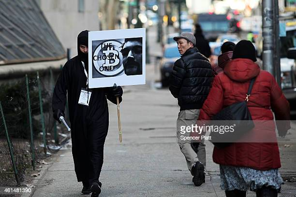 Max Dickstein walks with other supporters of Ross Ulbricht the alleged creator and operator of the Silk Road underground market in front of a...