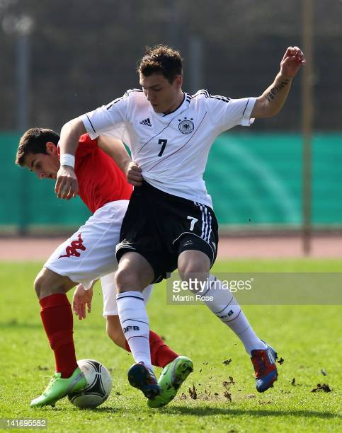 Max Dittgen of Germany and Miki Orachev of Bulgaria battle for the ball during the U17 Men's Elite Round match between Germany and Bulgaria on March...