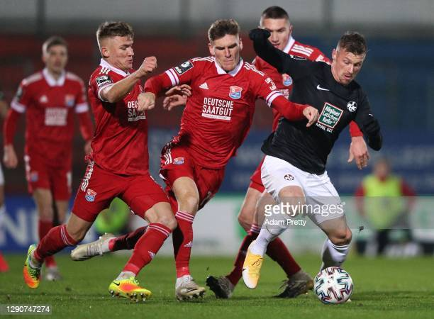 Max Dombrowka of SpVgg Unterhaching and Christoph Greger of SpVgg Unterhaching tackle Marvin Pourie 1. FC Kaiserslautern during the 3. Liga match...