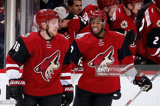 Max Domi and Anthony Duclair of the Arizona Coyotes celebrate after Domi scored a hat trick goal against the Edmonton Oilers during the third period...