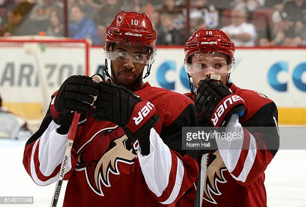 Max Domi and Anthony Duclair of the Arizona Coyotes look to the bench during a time out against the Anaheim Ducks at Gila River Arena on March 3 2016...