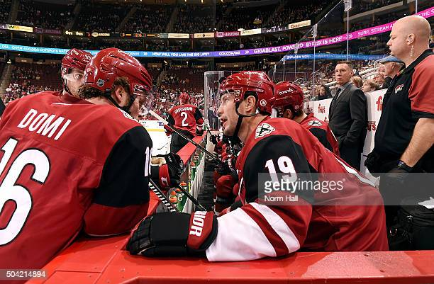 Max Domi and Shane Doan of the Arizona Coyotes talk during a second period timeout against the Nashville Predators at Gila River Arena on January 9...