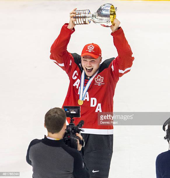 Max Domi of Canada celebrates with the trophy after a 54 win against Russia during the Gold medal game of the 2015 IIHF World Junior Championship on...
