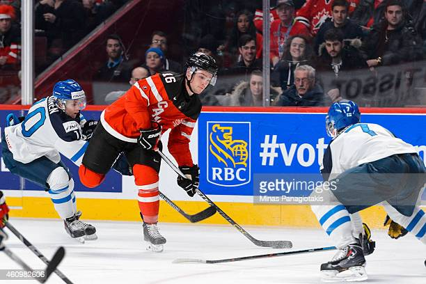 Max Domi of Team Canada looks to play the puck during the 2015 IIHF World Junior Hockey Championship game against Team Finland at the Bell Centre on...