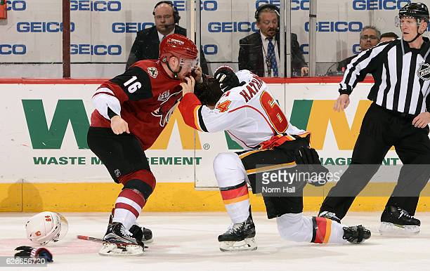 Max Domi of the Arizona Coyotes and Garnet Hathaway of the Calgary Flames tangle during the second period at Gila River Arena on December 8 2016 in...