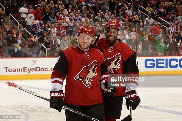 Max Domi of the Arizona Coyotes and teammate Anthony Duclair celebrate a goal against the Edmonton Oilers at Gila River Arena on January 12 2016 in...