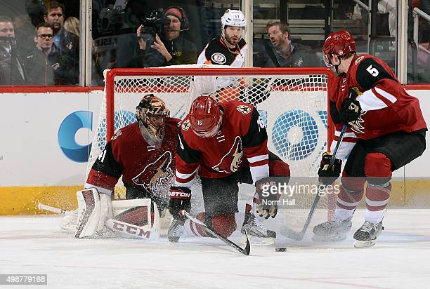 Max Domi of the Arizona Coyotes blocks a shot by the Anaheim Ducks in front of goaltender Mike Smith and Connor Murphy of the Coyotes during the...