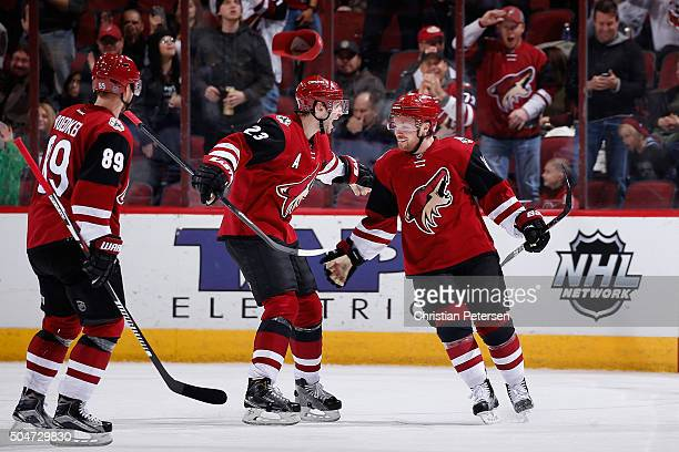 Max Domi of the Arizona Coyotes celebrates with Oliver Ekman-Larsson and Mikkel Boedker after Domi scored a hat trick goal against the Edmonton...