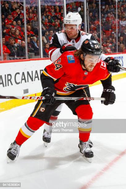 Max Domi of the Arizona Coyotes checks Rasmus Andersson of the Calgary Flames in an NHL game on April 3 2018 at the Scotiabank Saddledome in Calgary...