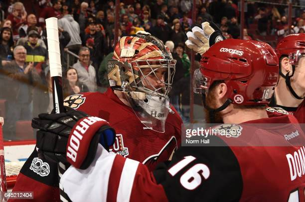 Max Domi of the Arizona Coyotes congratulates teammate Marek Langhamer after a 32 victory against the Anaheim Ducks at Gila River Arena on February...