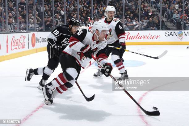 Max Domi of the Arizona Coyotes handles the puck against Alex Iafallo of the Los Angeles Kings at STAPLES Center on February 3 2018 in Los Angeles...