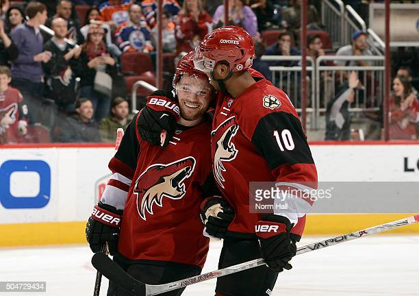 Max Domi of the Arizona Coyotes is congratulated by teammate Anthony Duclair after his hat trick against the Edmonton Oilers during the third period...