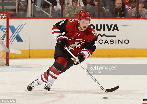 Max Domi of the Arizona Coyotes skates with the puck against the Chicago Blackhawks at Gila River Arena on December 29 2015 in Glendale Arizona