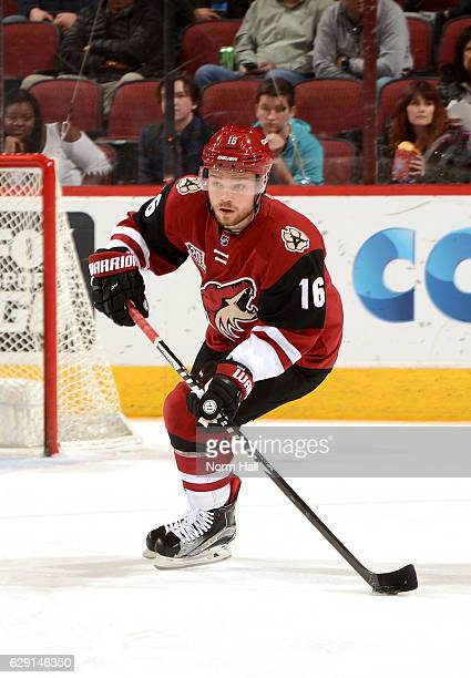 Max Domi of the Arizona Coyotes skates with the puck against the Calgary Flames at Gila River Arena on December 8 2016 in Glendale Arizona