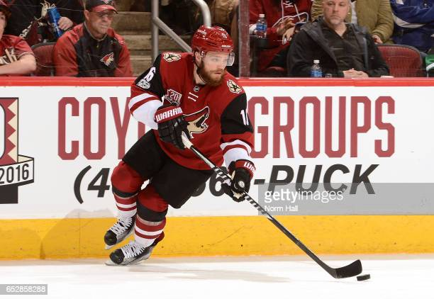 Max Domi of the Arizona Coyotes skates with the puck against the New Jersey Devils at Gila River Arena on March 11 2017 in Glendale Arizona