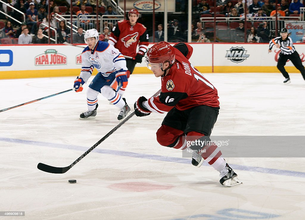 Max Domi #16 of the Arizona Coyotes skates with the puck against the Edmonton Oilers during the third period at Gila River Arena on November 12, 2015 in Glendale, Arizona.