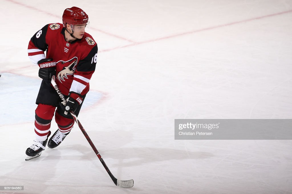 Max Domi #16 of the Arizona Coyotes skates with the puck during the first period of the NHL game against the Vancouver Canucks at Gila River Arena on February 25, 2018 in Glendale, Arizona. The Canucks defeated the Coyotes 3-1