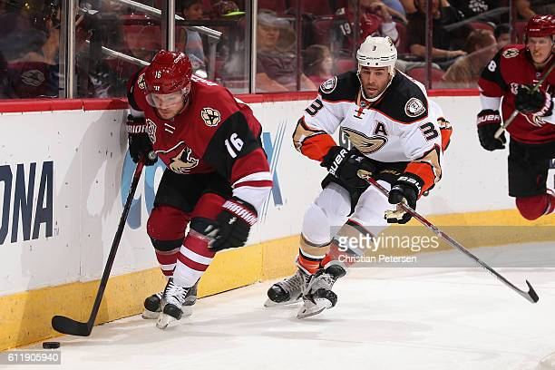 Max Domi of the Arizona Coyotes skates with the puck past Clayton Stoner of the Anaheim Ducks during the first period of the preseason NHL game at...