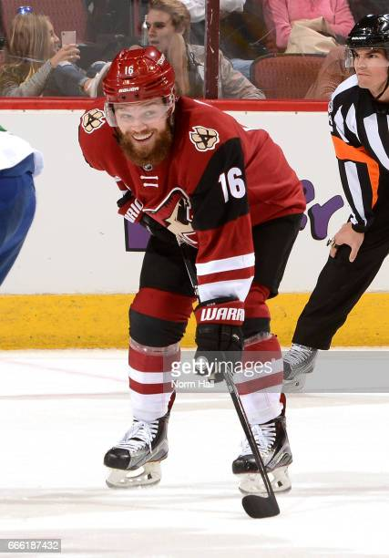 Max Domi of the Arizona Coyotes smiles at his teammates on the bench during a stop in play against the Vancouver Canucks net at Gila River Arena on...