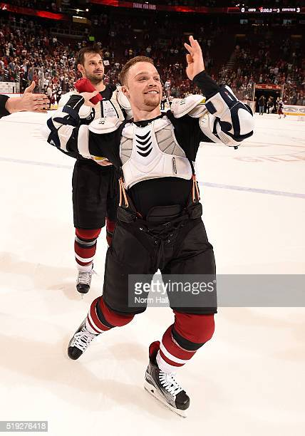 Max Domi of the Arizona Coyotes throws a tee shirt to the fans as part of fan appreciation night after a game against the Washington Capitals at Gila...