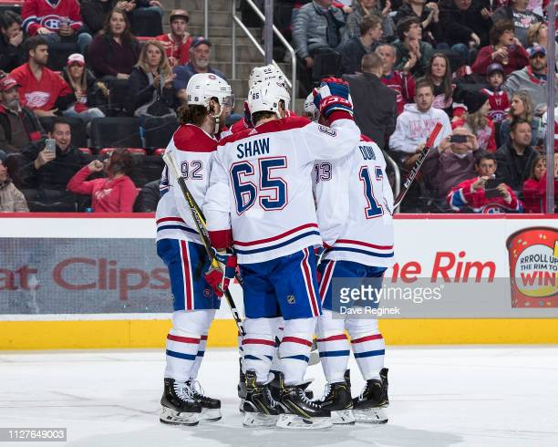 Max Domi of the Montreal Canadiens celebrates his second period goal with teammates Jonathan Drouin and Andrew Shaw during an NHL game against the...