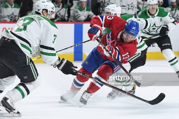 Max Domi of the Montreal Canadiens fights for the puck against John Klingberg of the Dallas Stars in the NHL game at the Bell Centre on October 30...