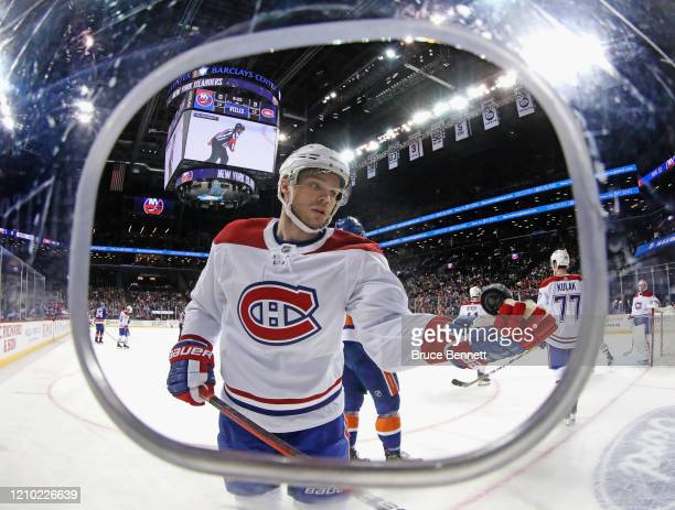 Max Domi of the Montreal Canadiens flips the puck into his own glove during a break in the play against the New York Islanders at the Barclays Center...