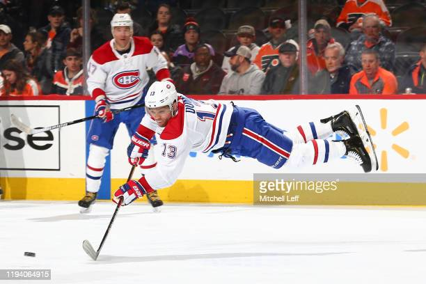 Max Domi of the Montreal Canadiens reaches for the puck against the Philadelphia Flyers in the second period at the Wells Fargo Center on January 16...