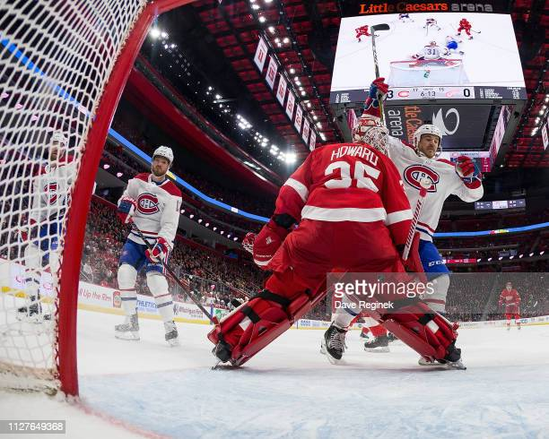 Max Domi of the Montreal Canadiens scores a second period goal past goaltender Jimmy Howard of the Detroit Red Wings as teammate Andrew Shaw of the...