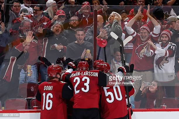 Max Domi Oliver EkmanLarsson and Antoine Vermette of the Arizona Coyotes celebrate with Mikkel Boedker after Boedker scored a hat trick goal against...