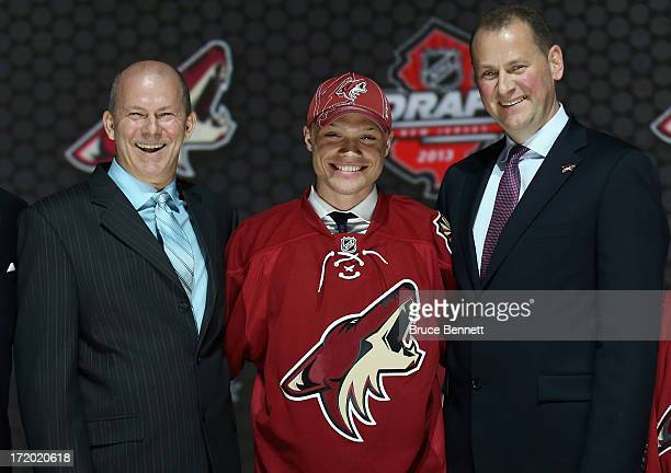 Max Domi poses with Brad Treliving Vice President of Hockey Operations and Assistant General Manager after Domi was selected number overall in the...