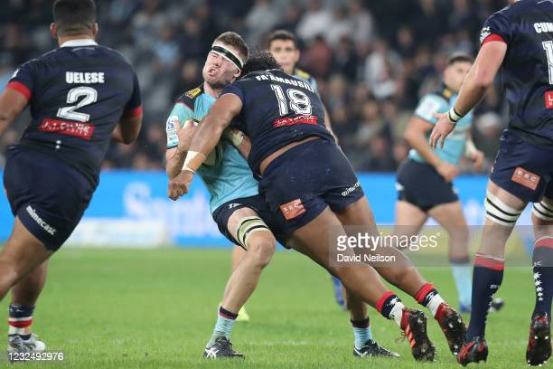 Max Douglas of the Waratahs is hit with a tackle from Pone Fa'amausili of the Rebels, who received a red card for the foul during the round 10 Super...