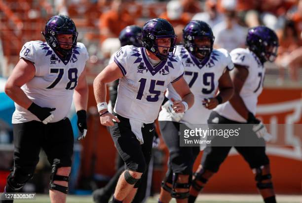 Max Duggan of the TCU Horned Frogs celebrates after rushing for a touchdown in the fourth quarter against the Texas Longhorns at Darrell K...