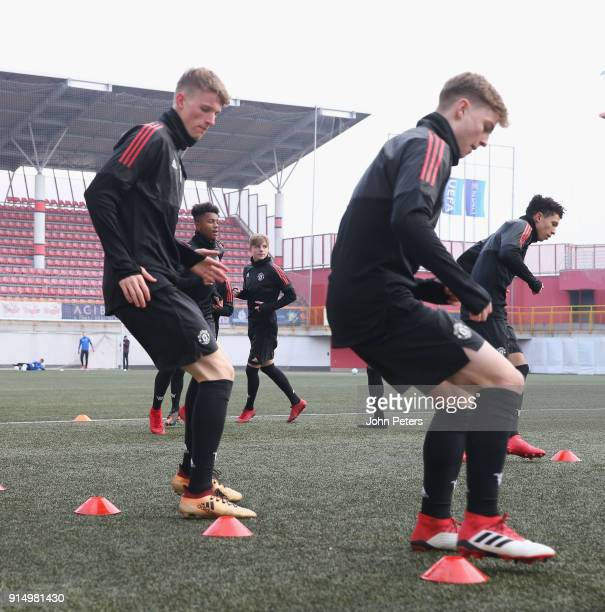 Max Dunne and George Tanner of Manchester United U19s in action during a training session at Vozdovac Stadium on February 6 2018 in Belgrade Serbia