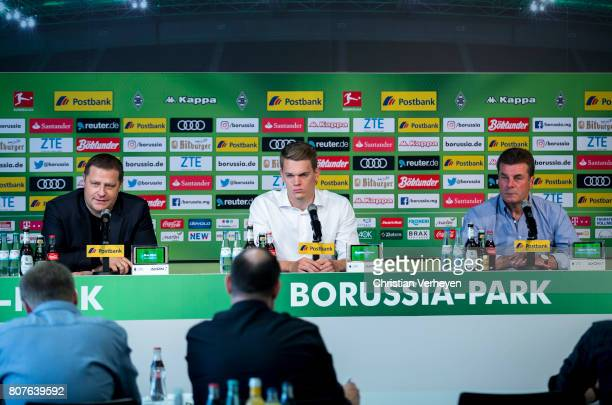 Max Eberl Matthias Ginter and Dieter Hecking during a press conference after Matthias Ginter signs a contract with Borussia Moenchengladbach at...