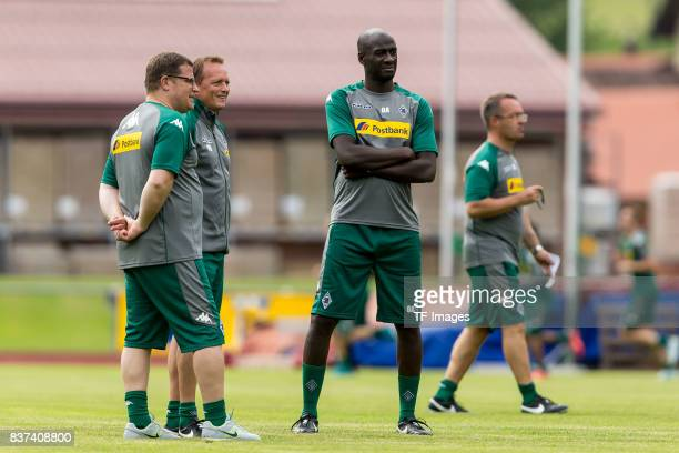 Max Eberl of Borussia Moenchengladbach Cocoach Otto Addoof Borussia Moenchengladbach and Cocoach Dirk Bremser of Borussia Moenchengladbach looks on...