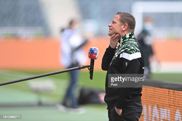 Max Eberl, Sporting Director of Borussia Moenchengladbach is interviewed prior to the Bundesliga match between Borussia Moenchengladbach and...