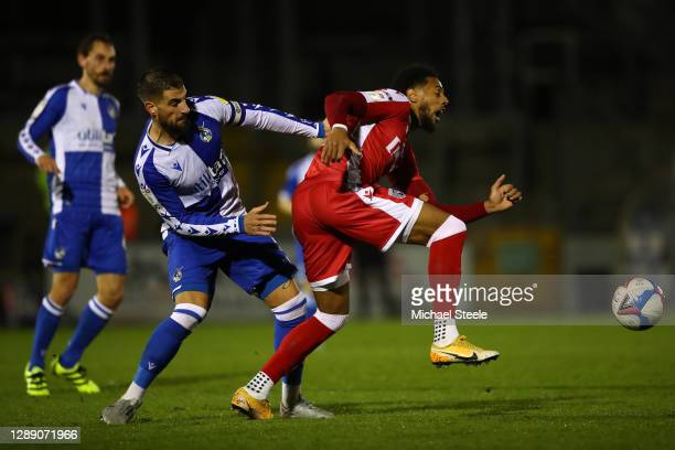 Max Ehmer of Bristol Rovers challenges Vadaine Oliver of Gillingham during the Sky Bet League One match between Bristol Rovers and Gillingham at...