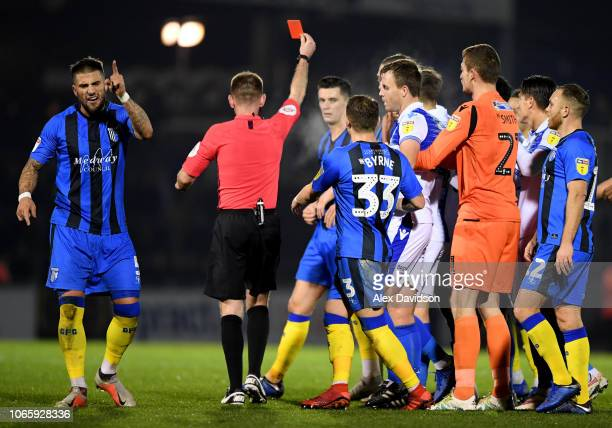 Max Ehmer of Gillingham protests as referee Ollie Yates awards a red card to Callum Reilly during the Sky Bet League One match between Bristol Rovers...