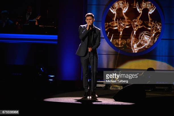 Max Ehrich performs Hallelujah on stage during an in memoriam tribute at the 44th annual Daytime Emmy Awards at Pasadena Civic Auditorium on April 30...