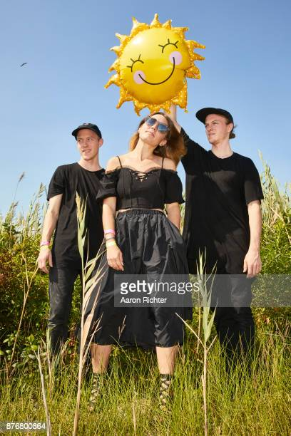 Max Ernst Chelsea Lee and Spencer Ernst of SHAED are photographed for Billboard Magazine on August 19 2017 at the Billboard Hot 100 Music Festival at...