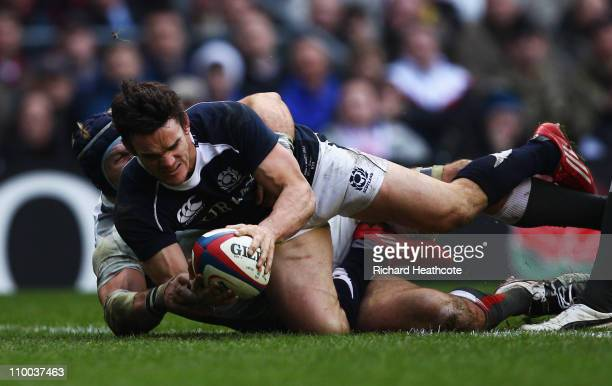 Max Evans of Scotland beats James Haskell of England to score their first try during the RBS 6 Nations Championship match between England and...