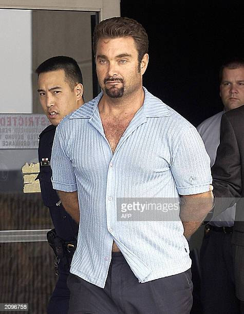 Max Factor fortune heir Andrew Luster is brought out of the Los Angeles International Airport under the custody of Los Angeles police and FBI agents...