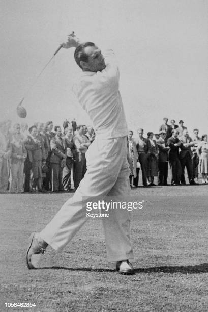 Max Faulkner of Great Britain plays off the 2nd fairway on as spectators look on during the 80th Open Championship on 6 July 1951 at the Royal...