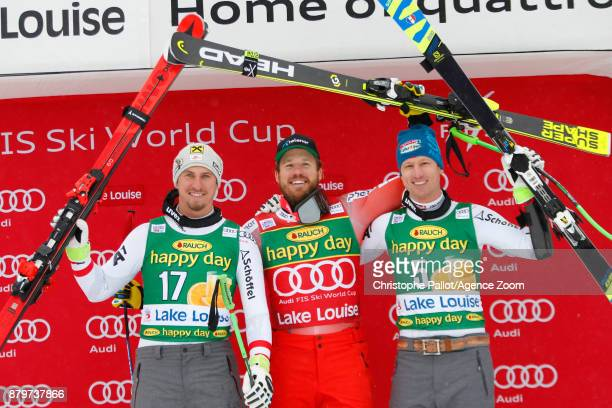 Max Franz of Austria takes 2nd place Kjetil Jansrud of Norway takes 1st place Hannes Reichelt of Austria takes 3rd place during the Audi FIS Alpine...
