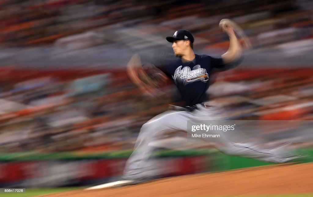 Max Fried #61 of the Atlanta Braves pitches during a game against the Miami Marlins at Marlins Park on October 1, 2017 in Miami, Florida.