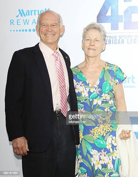 Max Gail and guest arrive at the Los Angeles premiere of 42 held at TCL Chinese Theatre on April 9 2013 in Hollywood California