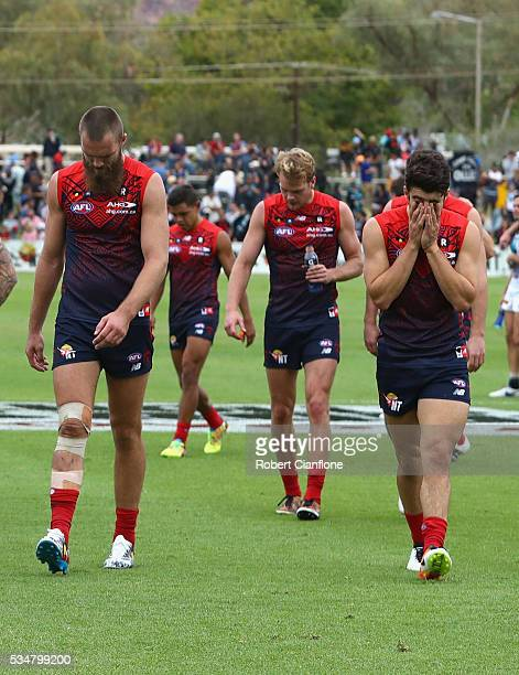 Max Gawn and Christian Petracca of the Demons walk off the ground after they were defeted by the Power during the round 10 AFL match between the...