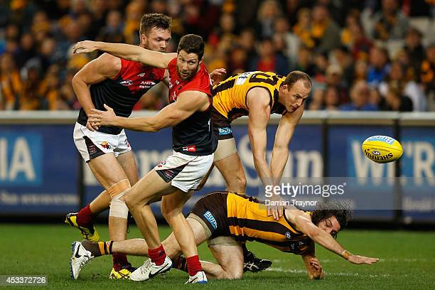 Max Gawn and James Frawley of the Demons compete against David Hale and Matt Spangher of the Hawks during the round 20 AFL match between the Hawthorn...